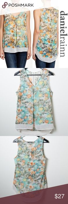 """Daniel Rainn Floral Print Tank Sheer Sleeveless Daniel Rainn size medium tank. V-neck, sleeveless tank. Blue, brown, orange yellow floral pattern with white trim. Exposed partial back zipper. Contrast trimmed hi-lo hem. Partially sheer. Great preloved condition. No notable stains, roles, snags or rips. Measurements approximately 27.5"""" shoulder to front hem. Shoulder to back hen is approximately 30"""". Daniel Rainn Tops Tank Tops"""