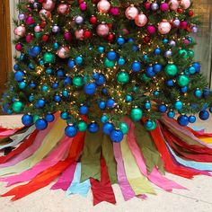 Radiant Ribbon Christmas Tree Skirt Tie together your Christmas colour scheme with this Christmas tree skirt made from richly coloured ribbons. Cut varying lengths of thick, wire-edge ribbon in different colours, then attach them to the tree trunk with florist's wire.