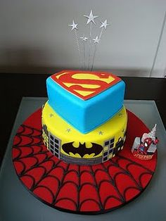 DC and Marvel are mixed on most cakes...but Guy likes SUPER FRIENDS and SUPER HERO SQUAD...hmm...what to do, what to do...