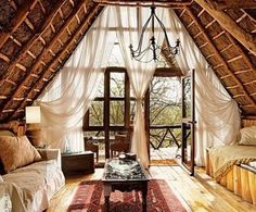 Attic- likening those billowy white curtains! And the floor to ceiling window panes!