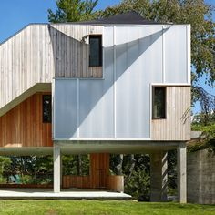 New York-based Narofsky Architecture has built this house on a hurricane-damaged site in Long Island, with wooden cladding and furniture made from trees knocked down during the storm.