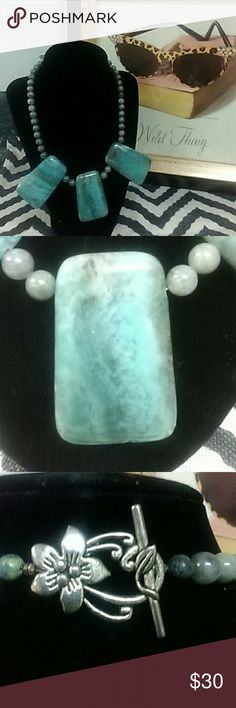 Turquoise colored natural stone. Very nice piece. Has 3 large pendants. Handmade by Yvonne. Jewelry Necklaces