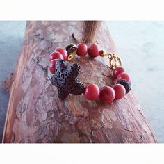"Beaded bracelet with ""Coral & Black Lava"" gemstones and gold-plated charms . Coral Stone, Bracelet Making, Lava, Plating, My Etsy Shop, Beaded Bracelets, Charmed, Gemstones, Check"