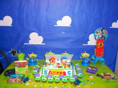 toy story party, wall decorated with blue paper and white clouds to look like Andy's room