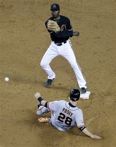 Arizona Diamondbacks' Didi Gregorius forces out San Francisco Giants' Buster Posey (28) as he turns a double play on Giants' Pablo Sandoval during the third inning of a baseball game, Saturday, June 8, 2013, in Phoenix. (AP Photo/Matt York)