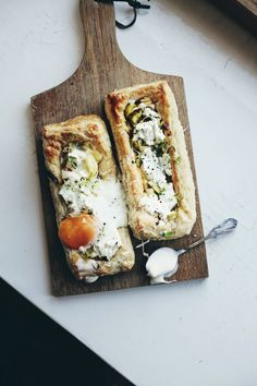 Breakfast tarts with leeks, lemon zest, soft goat cheese and a cracked egg -- can't wait to make this one lazy weekday morning!