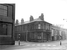 MSE/2/1/4 Black and white photograph showing the 'Saddle Hotel', Westfield Street, St.Helens c.1960 MSE - The Frank Sheen Collection 2 - Photographs showing various buildings, events and housing in St.Helens. 1 - Photographs showing public houses in the St.Helens area.