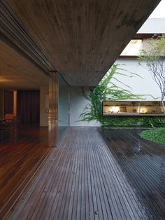 By keeping the front and back gardens at the same elevation as the living area in a São Paulo abode, architect Marcio Kogan created one giant living space. A large overhang means that even on a rainy day, the residents can live practically without walls. Four custom-built sliding doors divide indoor and outdoor spaces. Photo by: Cristóbal Palma Photo by: Cristóbal Palma
