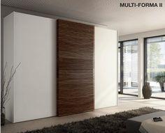 Hulsta multiforma II le solist,midden deur hout paneel ,design, schuifdeurkast kernnoten of structuur essen,ambacht,dealer: slaapkenner theo bot