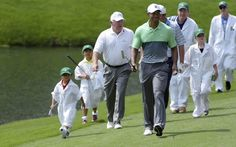 Charlie and Sam Woods walk next to Tiger Woods and Mark O'Meara. (USATSI)