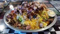 Delano Barbeque Co. -  Eating light? Our 1-, 2- or 3-meat salad will fill you up without slowing you down. (2-Meat pictured)