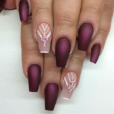 Maroon Coffin Nails with nude. Maroon color is always a plus, when you wear it on your nails. and when it comes to coffin nails, this look great with the rhinestones and white lines.