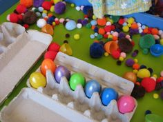 Easter Sensory Play Table with pompoms, egg cartons and plastic eggs