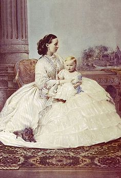 Alexandra Iosifovna with son Viacheslav.  Is that a dgg sitting on the end of her huge hoop skirt?
