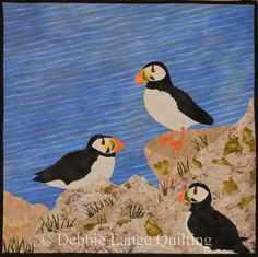 """North Atlantic Puffins Quilted Wallhanging.Finished size 32"""" by 32"""". And original design by Debbie Lange and Eric Lange.Blue water is hand dyed. I can make a custom Keepsake Quilt for you. email to: DebbieLangeQuilting@gmail.com www.DebbieLangeQuilting.blogspot.com.  Facebook:DebbieLangeQuilting. Pinterest:DebbieLangeQuilting"""