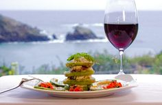 Dungeness Crab, Feta cheese and heirloom tomato appetizer, glass of Pinot Noir, and Pacific blufftop view.