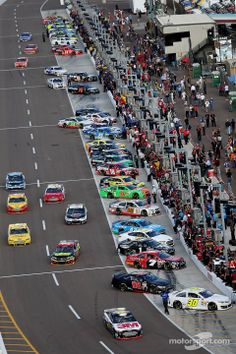 Cars leave pit road at Phoenix. 2012 was when 6 of us went to see a race in Phoenix,from TBAY it was awsome..