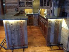 Custom reclaimed wood bar, Stone, wrought iron & lighting.  Vintage barn siding wood hand picked.