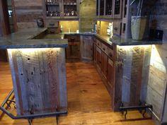 Custom reclaimed wood bar, Stone, wrought iron & lighting.  Vintage barn siding wood hand picked.