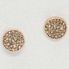 Sparkling gold earrings.