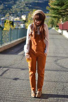 Preziosa of Marzipan. rust orange overalls on a pretty white blouse.