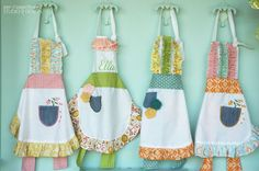 I am smitten with these cute aprons over at Pen and Paper flowers. (made by Made by Morgan)