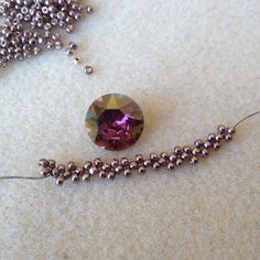 One advantage of being a Swarovski ambassador is that I get to put my hands on lots of their beautiful DIY products. I recently found myself oogling over a 13mm (ss55) sparkly Xirius chaton (#1088) in Lilac Shadow, which is, in my opinion, one of those chameleon colors that look great with almost any color…
