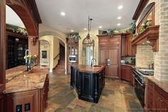 Traditional Two-Tone Kitchen Cabinets (Kitchen-Design-Ideas.org)  Like the black island & tile