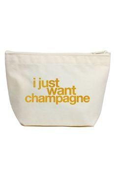 "A metallic foil message in gold makes a playful statement, ""I just want champagne"", on this canvas zip pouch perfect for carrying all the essentials."