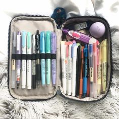 13:00 this has been quite requested, so this is what's in my pencil case!! a massive thank you to @kiplingglobal for sending me this gorgeous 50 Pens Pen Case, i'm obsessed with it  i like to keep all of my essentials on the left hand side for easy access, and then i have highlighters, ballpoint pens and just general pencil leads, sticky notes, tippex and lip balm on the other side  this pencil case is the perfect size for me to carry the pens that i use everyday  #Kipli...