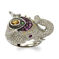 2.10 ct. t.w. pave diamond wild thing wears a headdress of .70 ct. tot. gem wt. pink and yellow sapphires and green garnets. In 14kt white gold with .15 ct. t.w. ruby eyes. 2.10 ct. t.w. pave diamond wild thing wears