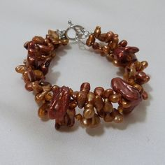 Check out this item in my Etsy shop https://www.etsy.com/listing/109998224/copper-freshwater-pearl-triple-strand