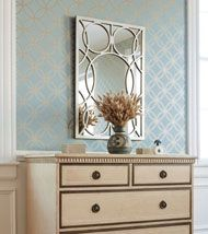 Thibaut, love the wallpaper and the mirror just adds to the great pattern.
