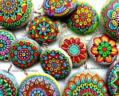 Close up for my mandala pendants & bracelets. #paintedstones #mandala