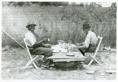 Stable hand and trainer eating picnic lunch before the Shelby County Horse Show and Fair, Shelbyville, KY, August 1940