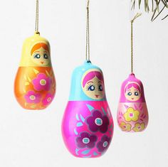 Pink and orange nesting doll ornaments.
