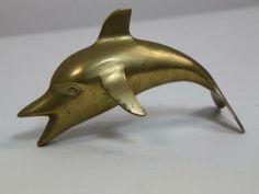 Vintage #brass #dolphin available at #Southampton #Mecox #interiordesign #MecoxGardens #furniture #shopping #home #decor #design #room #designidea #antiques #garden