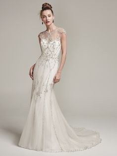 Sottero and Midgley - SYANNE, Eye-catching beading adorns the sleek silhouette of this tulle sheath wedding dress, featuring an artistically embellished illusion neckline and cap-sleeves. Complete with stunning beaded illusion keyhole back. Finished with crystal buttons over zipper closure.