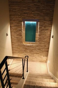 Interior built-in #waterfall with whole house #humidifier and surrounded in #drystack #ledgestone www.iversonsignaturehomes.com