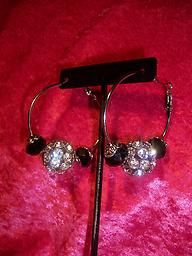 Black and silver rhinestone hoops.  They go with anything in your closet.