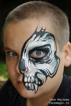 Half-face skull. Face paint by Tanya Maslova.