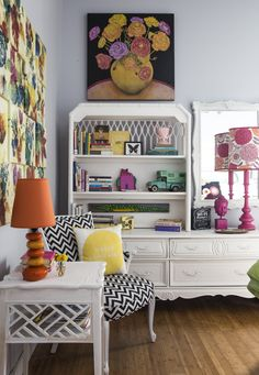 The guest room is bursting with color and fun decor. The black and white chair was a Salvation Army find, reupholstered by Tami.