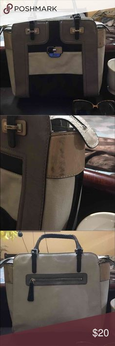 Guess Colorblock purse Only worn twice.  It's a really pretty purse and absolutely clean from the inside with no stains.  Please do refer to 2nd picture of black mark due to storage.  Other than that the purse looks pretty new.  Colors are a cream, taupe, black and pink. Guess Bags Shoulder Bags
