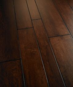 Engineered wood floors are better than planks because they are cheaper and easier to install than wood planks. It is plywood that can be glued to the concrete vs having to nail down your floor to strips of wood like you have to with solid wood strips. You still have the lasting quality of wood floors, it is just cheaper and easier to install. There is also the option of floating engineered hardwood or you could use strips that will click in together.