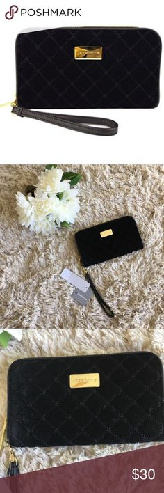 Liz Claiborne velvet quilted wristlet Liz Claiborne  Velvet  Quilted  Wristlet wallet  Retails for 45  Fair offers always accepted 💕 If you like this item, check my other listings for more fabulous finds. Bundles of two or more get exciting additional discounts. Liz Claiborne Bags Clutches & Wristlets