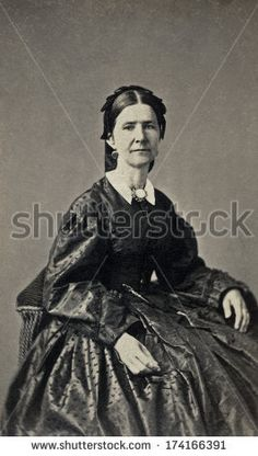 USA - OHIO - CIRCA 1865 - A vintage Cartes de visite photo of middle aged pioneer woman sitting in chair. She is dressed in hoop skirt dress. Photo from the Civil War Victorian era. CIRCA 1865