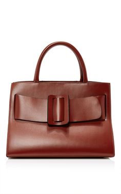 This **BOYY** bag is rendered in calfskin and features a top handle and an oversized buckle.