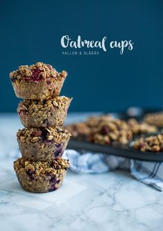 Gluten and dairy-free oatmeal cups with blueberries and raspberries.