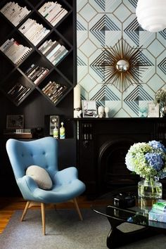 graphic black room with baby blue chair