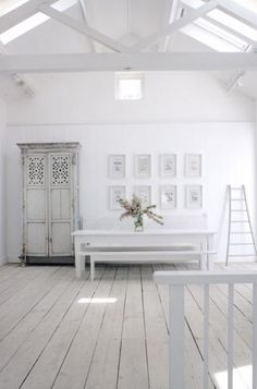 I'm so tired of clutter in my home, that this is staring to look like the most peaceful and tranquil home. I think I need a White Room.  ♥